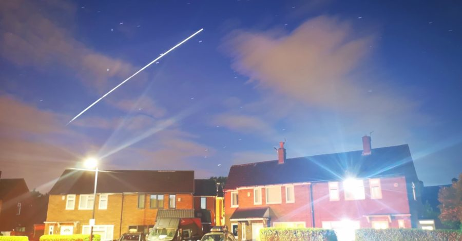 Space Station and shooting star light up sky over Sale